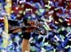 Feb 2, 2014; East Rutherford, NJ, USA; Detailed view as confetti falls as Seattle Seahawks quarterback Russell Wilson holds up the Vince Lombardi Trophy as he celebrates after Super Bowl XLVIII against the Denver Broncos at MetLife Stadium.  Mandatory Credit: Mark J. Rebilas-USA TODAY Sports