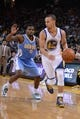 April 10, 2014; Oakland, CA, USA; Golden State Warriors guard Stephen Curry (30, right) drives to the basket against Denver Nuggets guard Aaron Brooks (0) during the third quarter at Oracle Arena. The Nuggets defeated the Warriors 100-99. Mandatory Credit: Kyle Terada-USA TODAY Sports