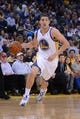 April 10, 2014; Oakland, CA, USA; Golden State Warriors guard Klay Thompson (11) dribbles the basketball during the third quarter against the Denver Nuggets at Oracle Arena. The Nuggets defeated the Warriors 100-99. Mandatory Credit: Kyle Terada-USA TODAY Sports