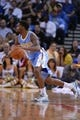 April 10, 2014; Oakland, CA, USA; Denver Nuggets guard Aaron Brooks (0) dribbles the basketball during the fourth quarter against the Golden State Warriors at Oracle Arena. The Nuggets defeated the Warriors 100-99. Mandatory Credit: Kyle Terada-USA TODAY Sports