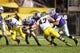 Dec 28, 2013; Tempe, AZ, USA; Kansas State Wildcats quarterback Jake Waters (15) against the Michigan Wolverines during the Buffalo Wild Wings Bowl at Sun Devil Stadium. Kansas State defeated Michigan 31-14. Mandatory Credit: Mark J. Rebilas-USA TODAY Sports